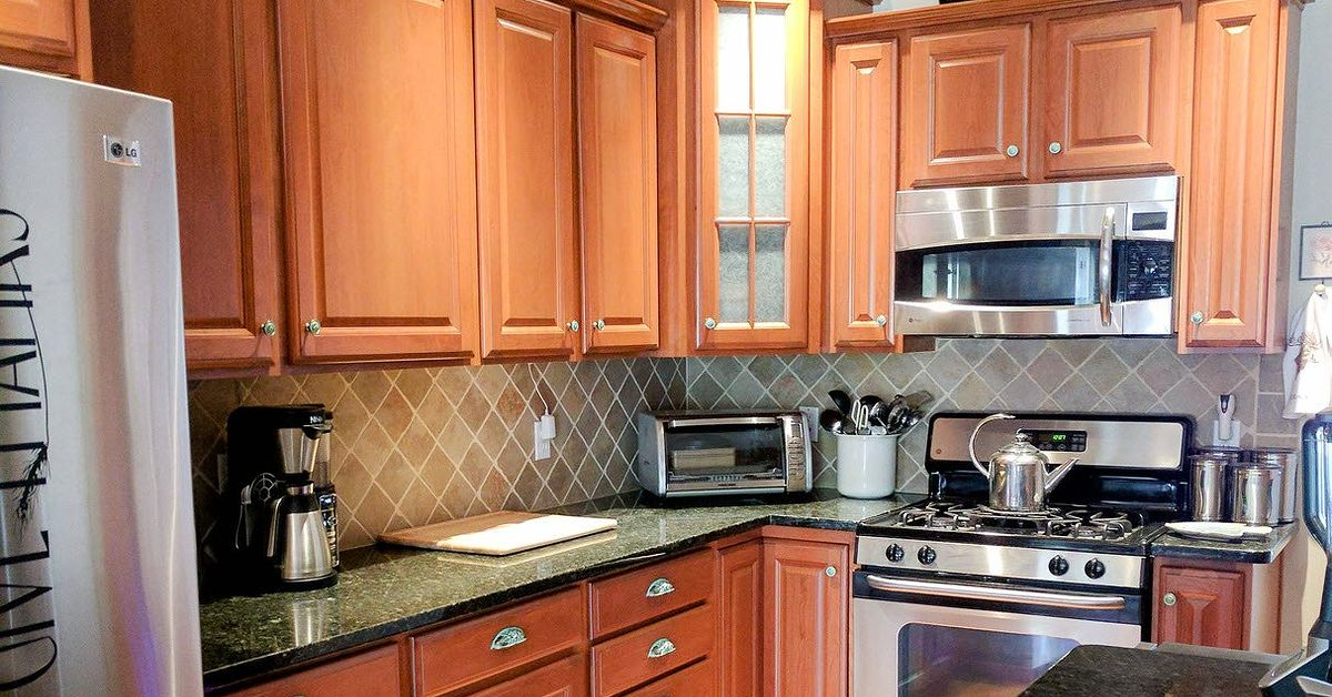 how to beautify your kitchen cabinets with new hardware. Black Bedroom Furniture Sets. Home Design Ideas