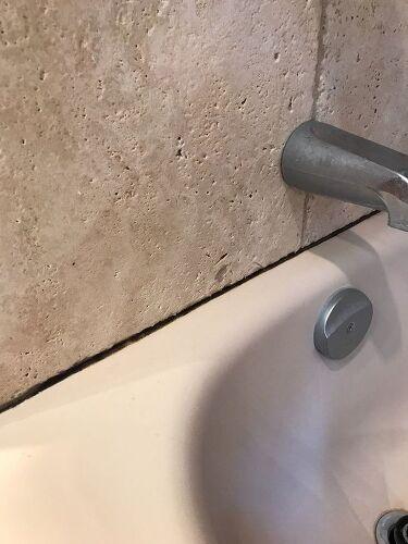 how do you clean bathroom caulking to remove black mildew