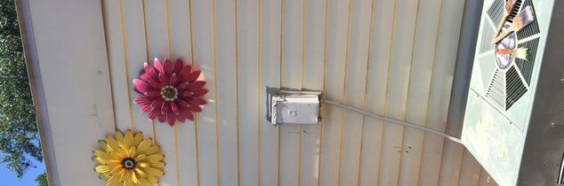 q how can i disguise an air conditioner electrical box on a patio wall