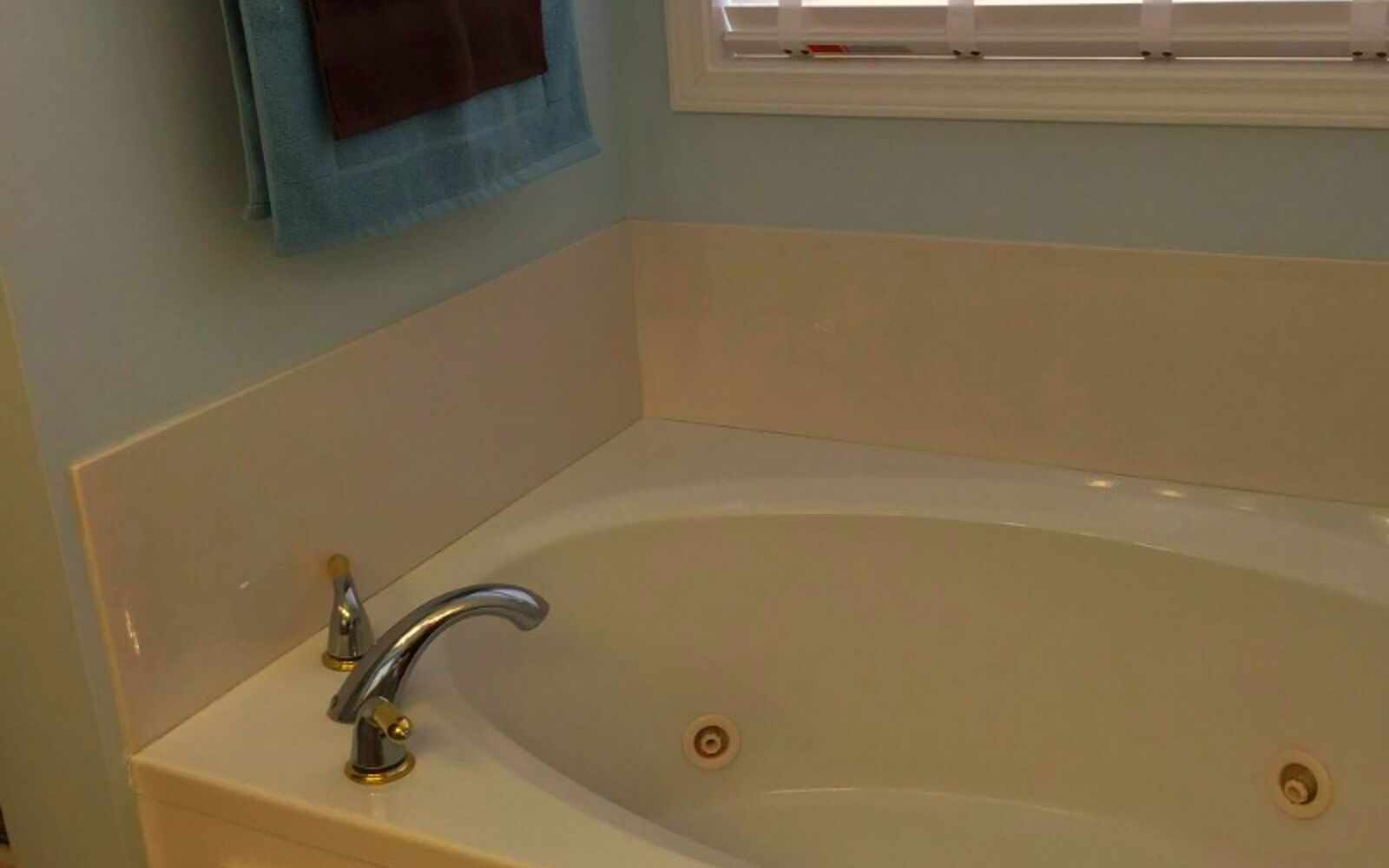 s 11 easy ways to refresh your old bathtub, Decorate With Affordable Tile