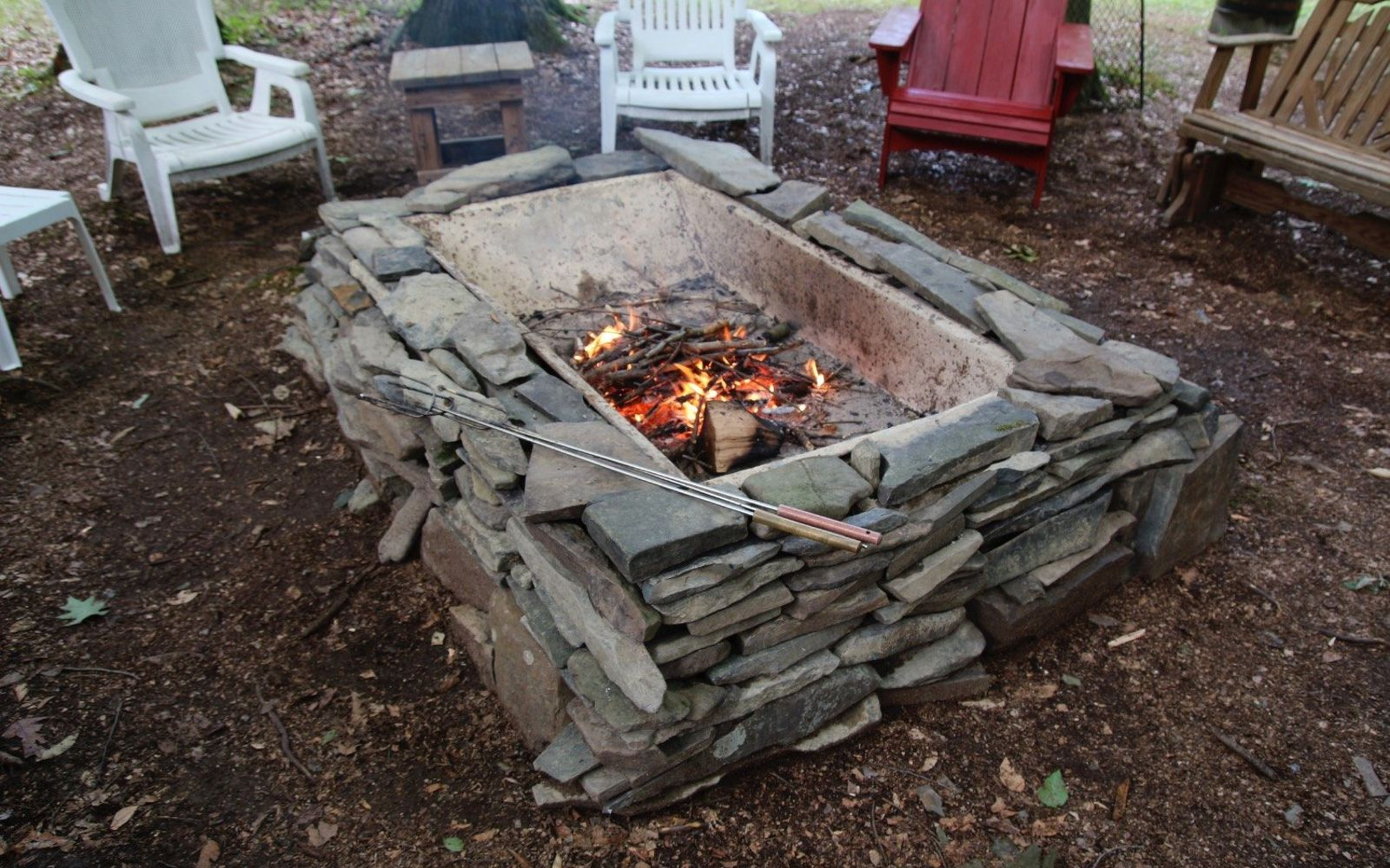 s 11 easy ways to refresh your old bathtub, Build A Fire Pit