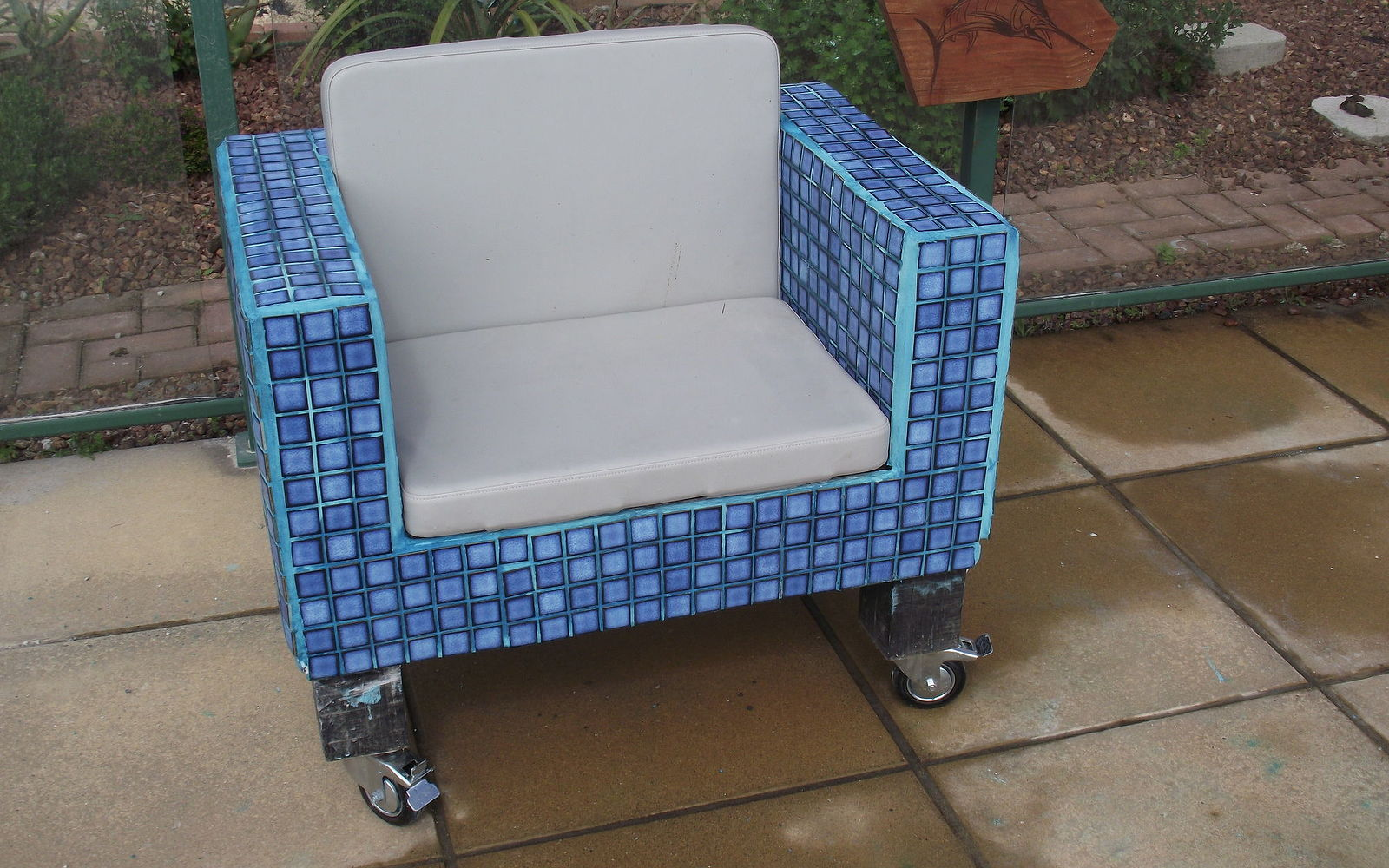 s 12 pool chair ideas we never would have thought of, Craft A Tiled Chair To Lounge In