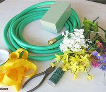 cheerful garden hose wreath perfect for summer