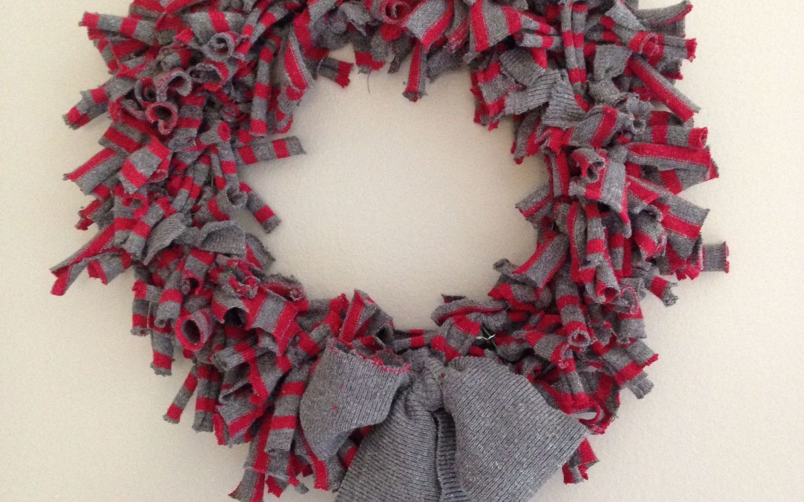s 17 tricks to make a gorgeous wreath in half the time, Wrap Your Unused Sweater Into A New Wreath