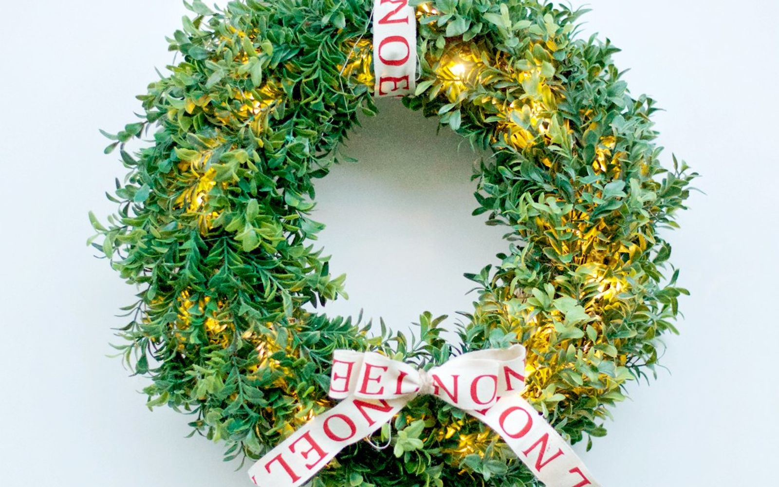 s 17 tricks to make a gorgeous wreath in half the time, Make A Faux Boxwood Door Decoration