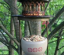 two candle holders become one bird feeder repurpose