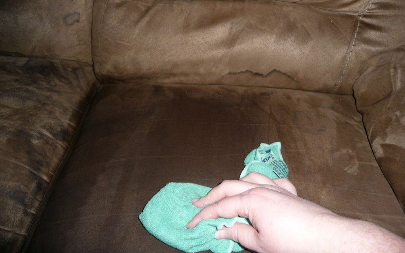 s 30 essential hacks for cleaning around your home, Cleanse A Microfiber Couch With A Cloth