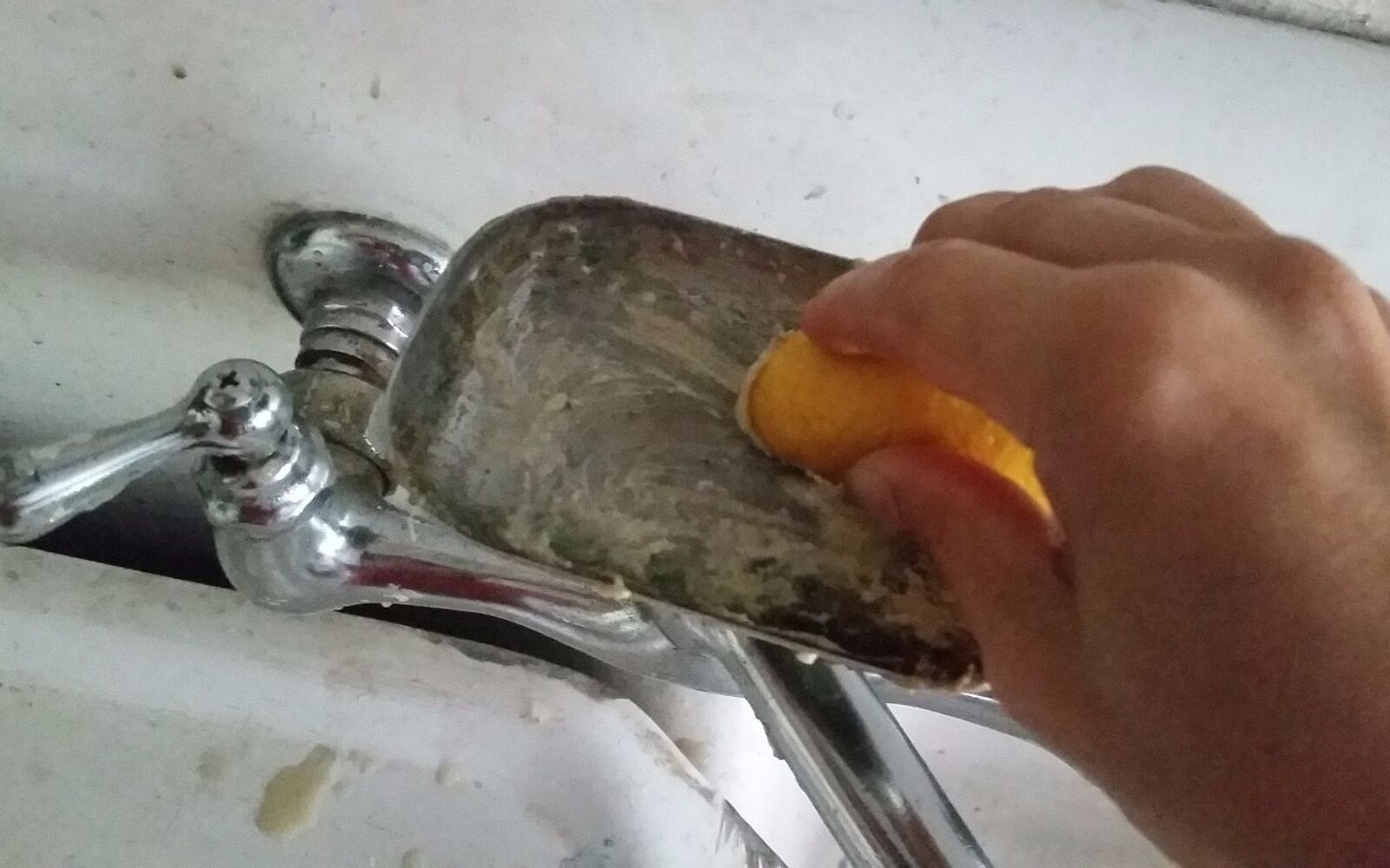 s 30 essential hacks for cleaning around your home, Make Your Faucet Sparkle With A Lemon