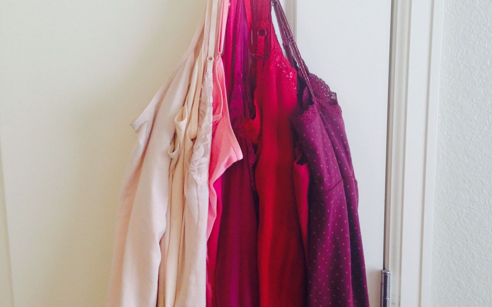 s 30 fun ways to keep your home organized, Organize Your Camis With A Hook