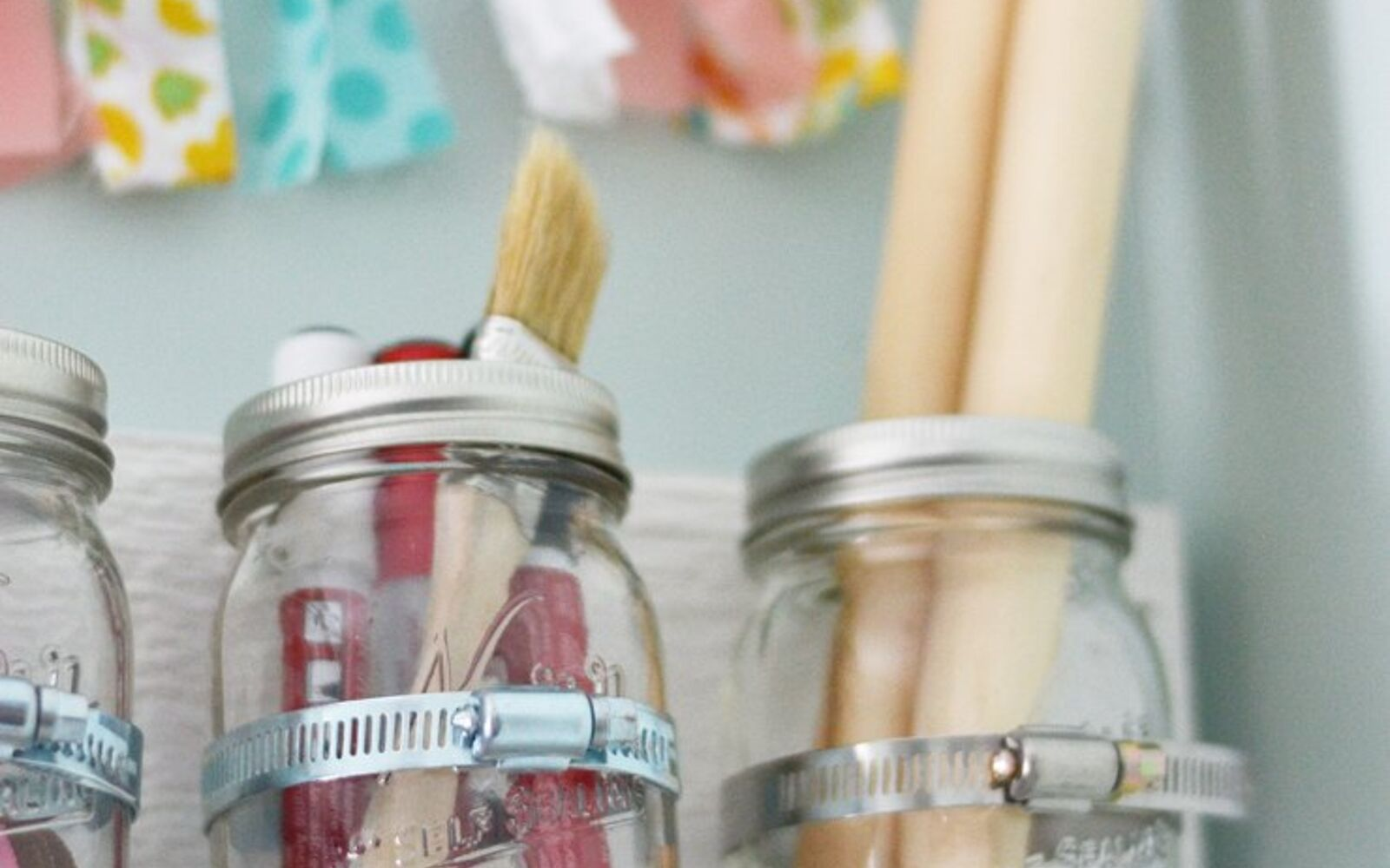 s 30 fun ways to keep your home organized, Clean Up Your Craft Room With Mason Jars