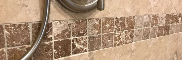 q how to clean and maintain tumbled marble in a shower