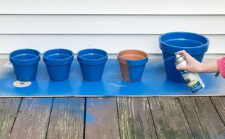 turn terra cotta pots blue for the cutest porch idea
