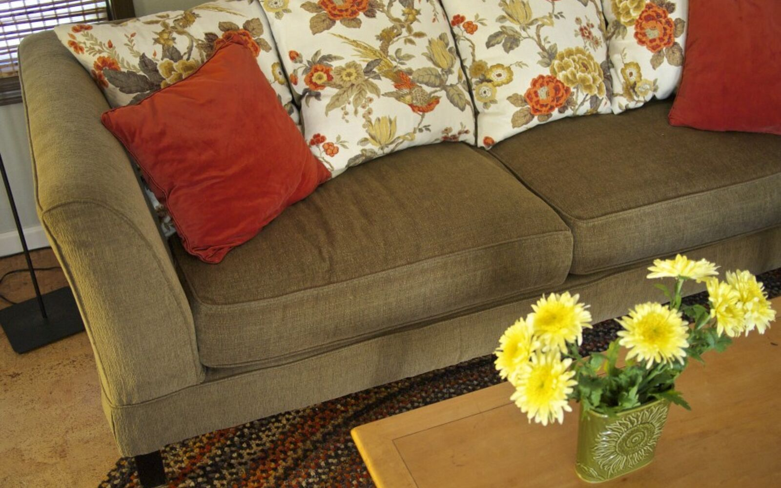 s hide your couch s wear and tear with these great ideas, Replace trashed cushions with throw pillows