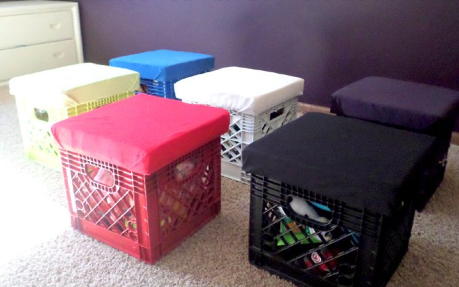 s 32 space saving storage ideas that ll keep your home organized, Keep the toys stored away with crates