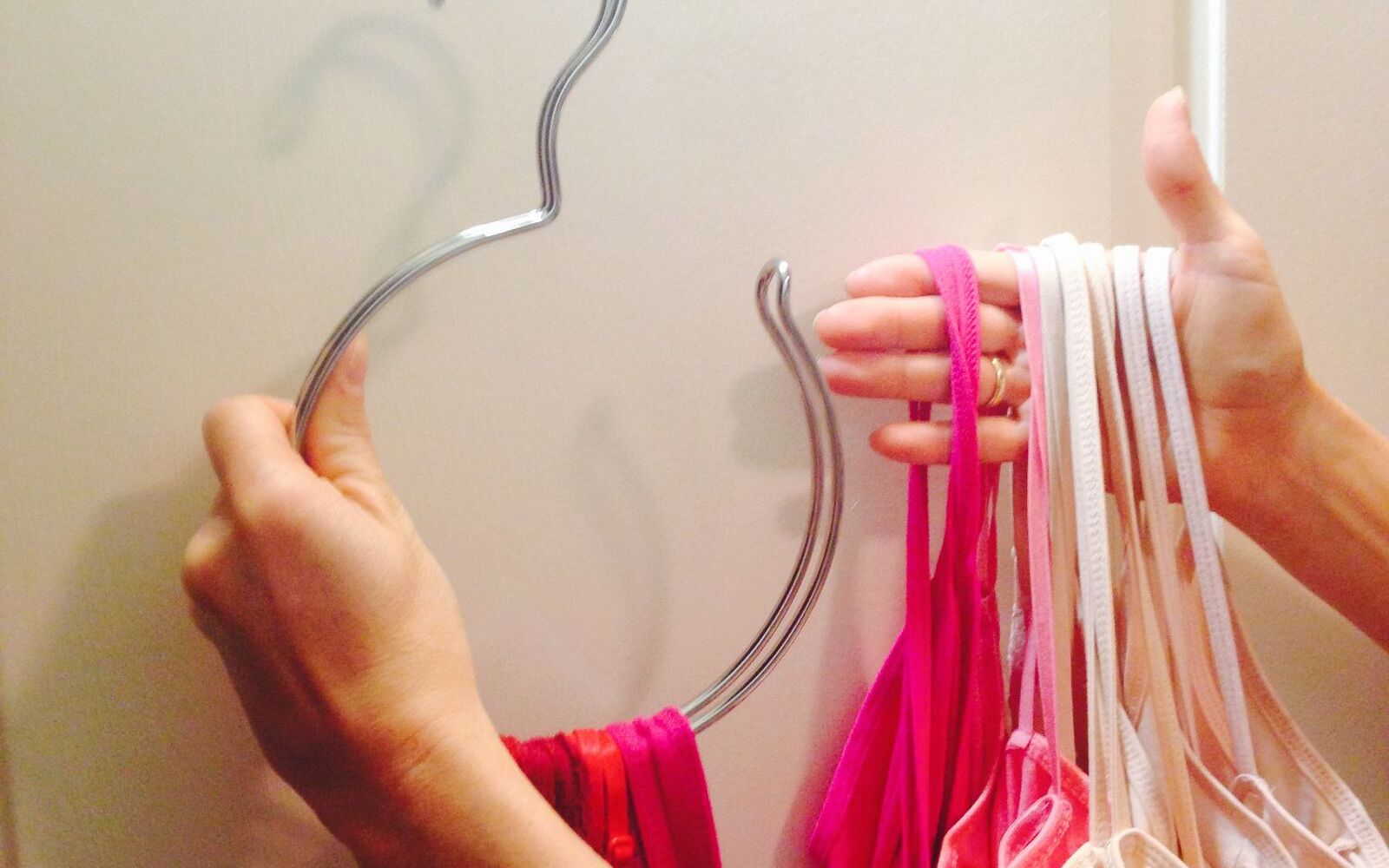 s 32 space saving storage ideas that ll keep your home organized, Store all your camis on an accessory hanger