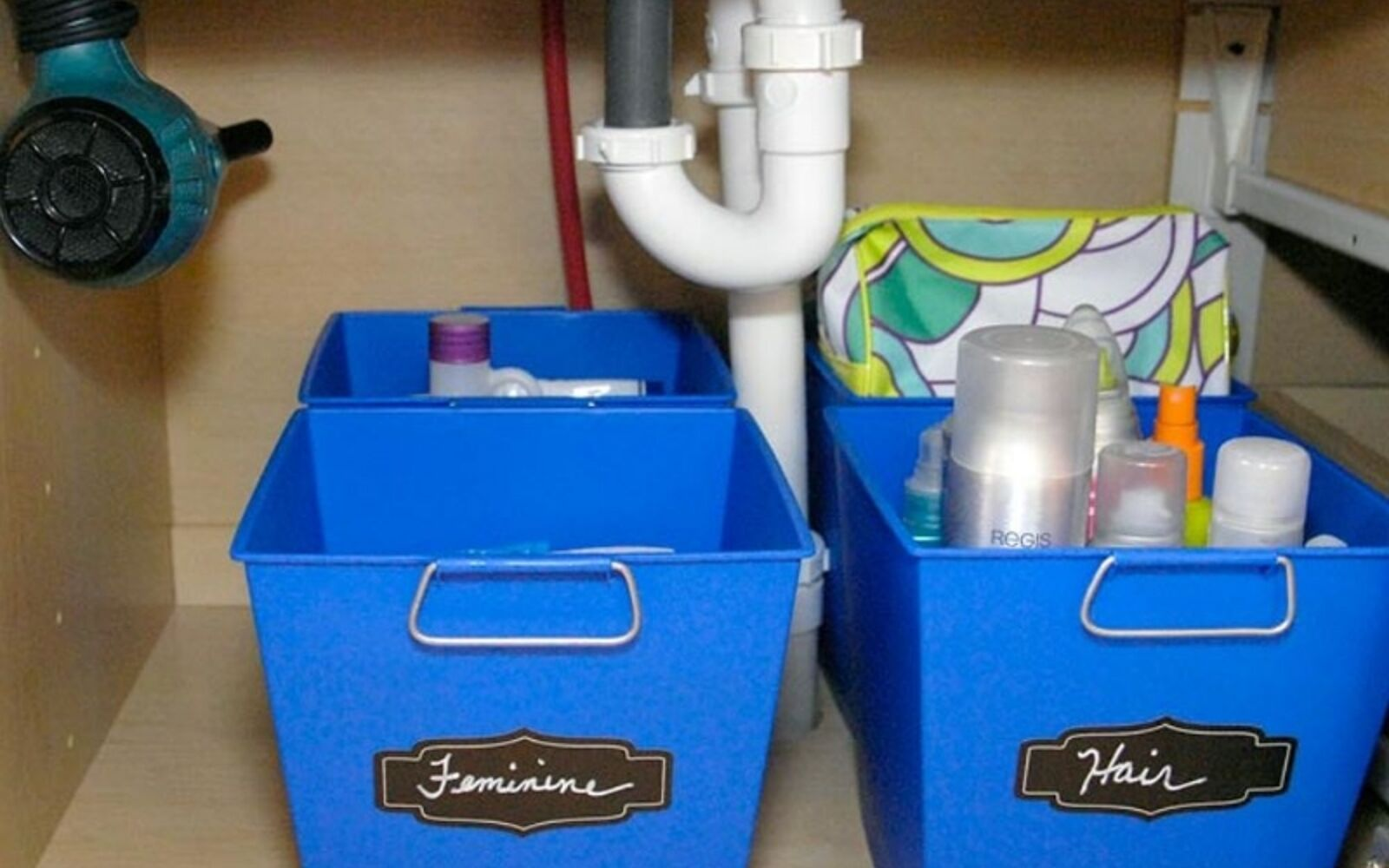 s 32 space saving storage ideas that ll keep your home organized, Organize your under the sink with bins