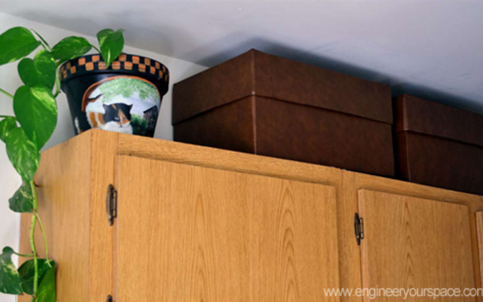 s 32 space saving storage ideas that ll keep your home organized, Fill the space above your cabinets with boxes
