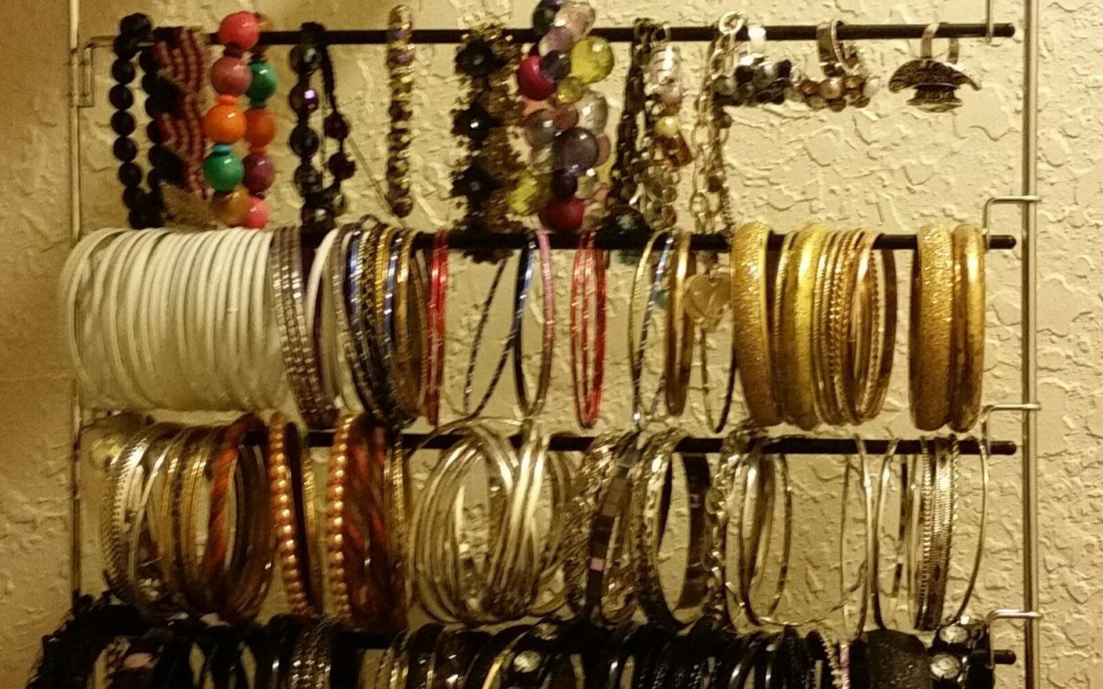 s 32 space saving storage ideas that ll keep your home organized, Organize your jewelry on a pants hanger