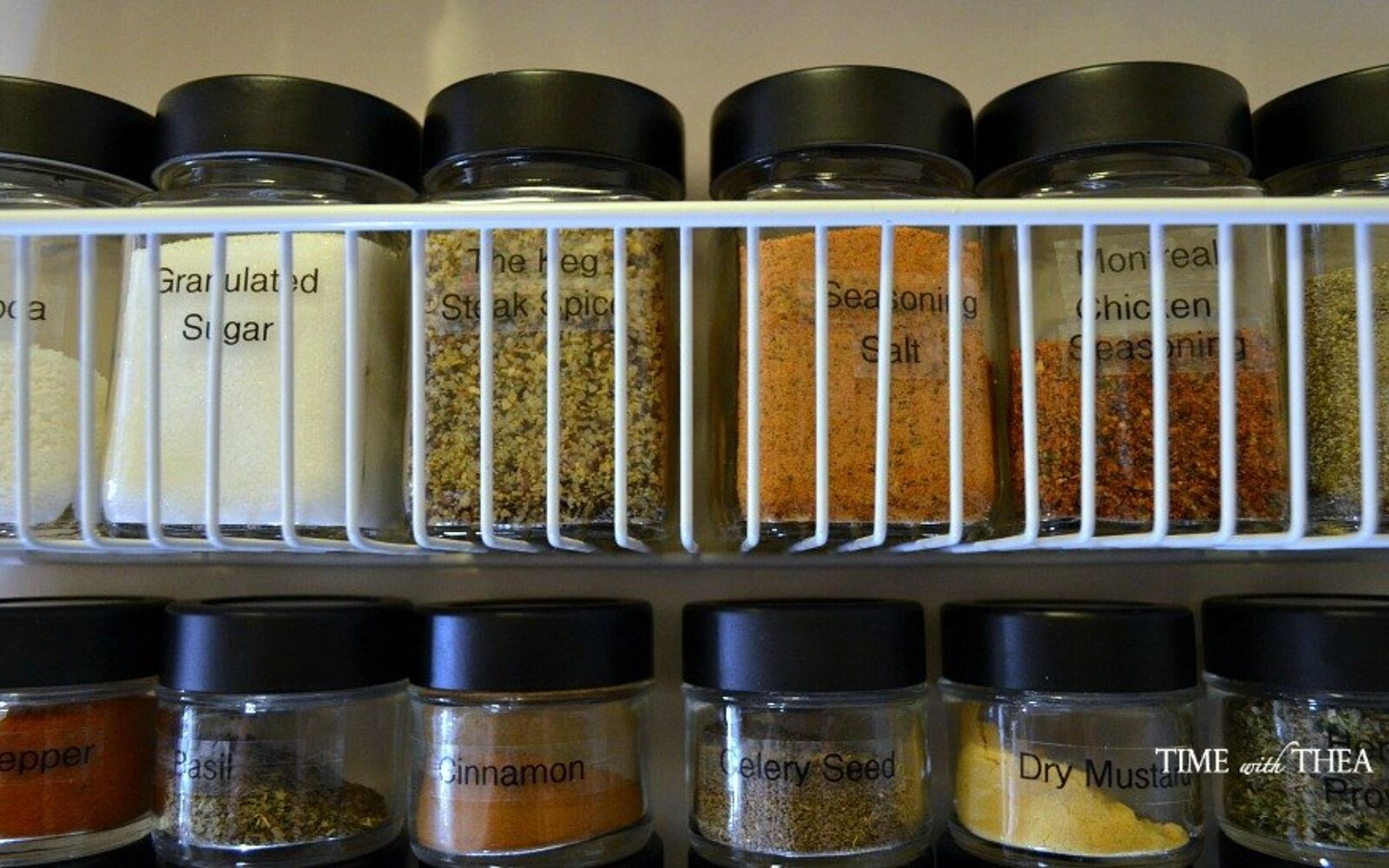 s 32 space saving storage ideas that ll keep your home organized, Use jars to organize your spices