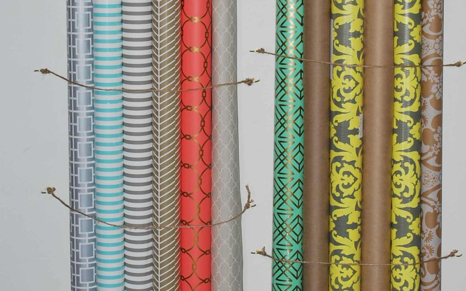 s 32 space saving storage ideas that ll keep your home organized, Put your gift wrap on the wall