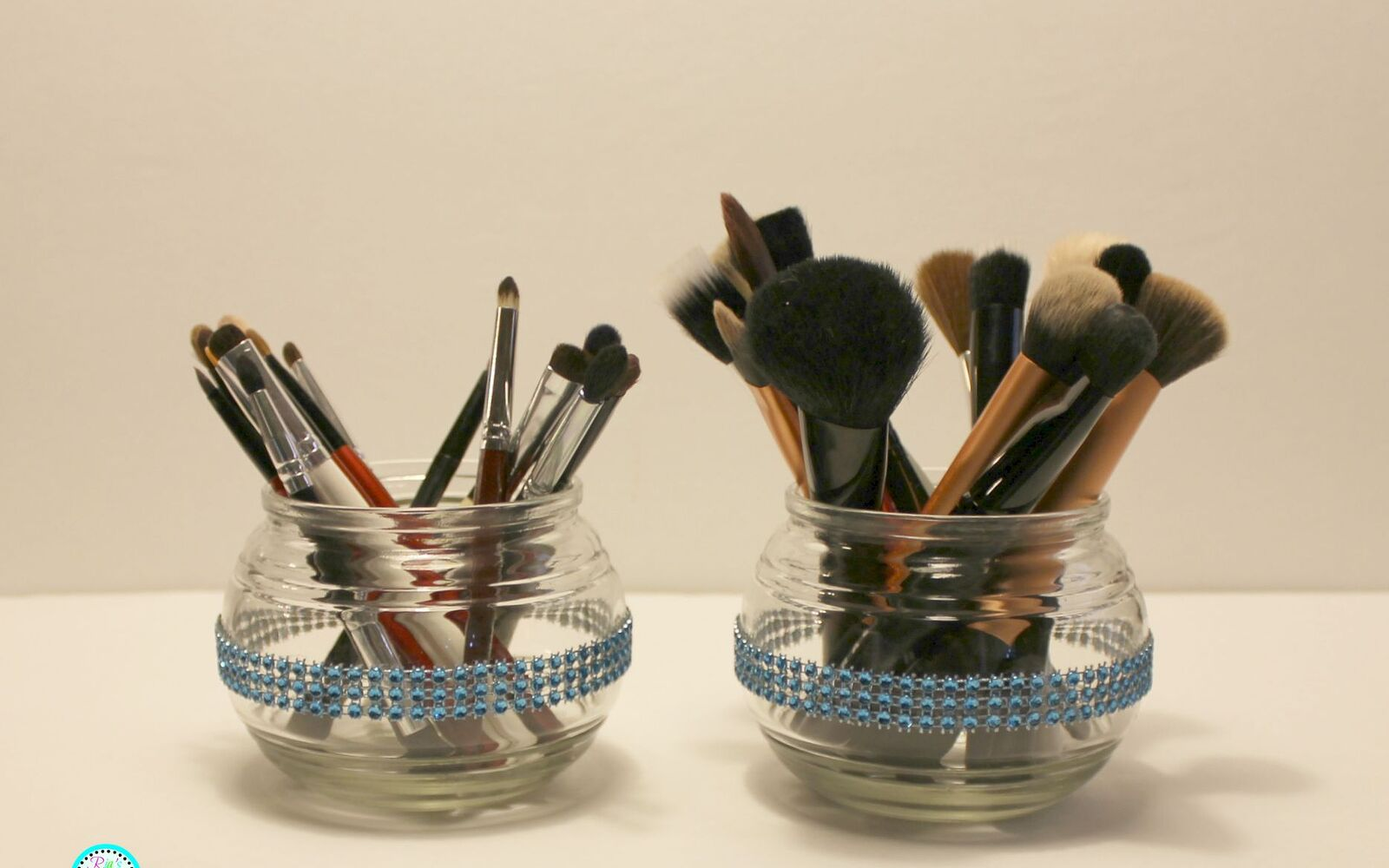 s 32 space saving storage ideas that ll keep your home organized, Use apothecary jars for makeup brushes