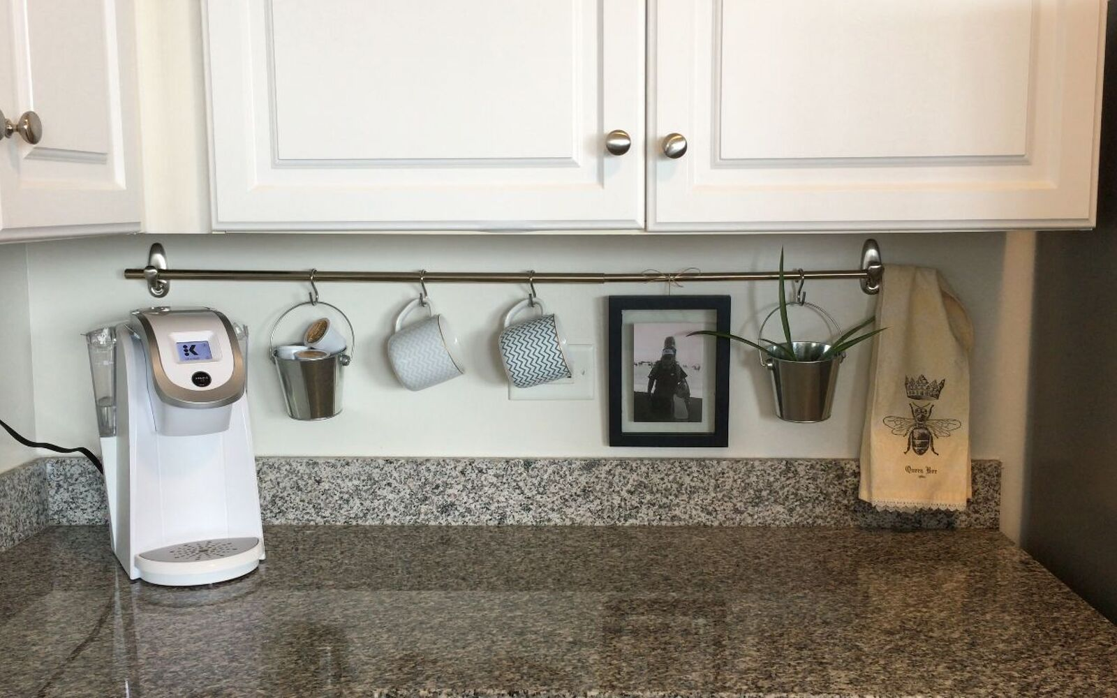s 32 space saving storage ideas that ll keep your home organized, Keep clutter off your counter with a rod