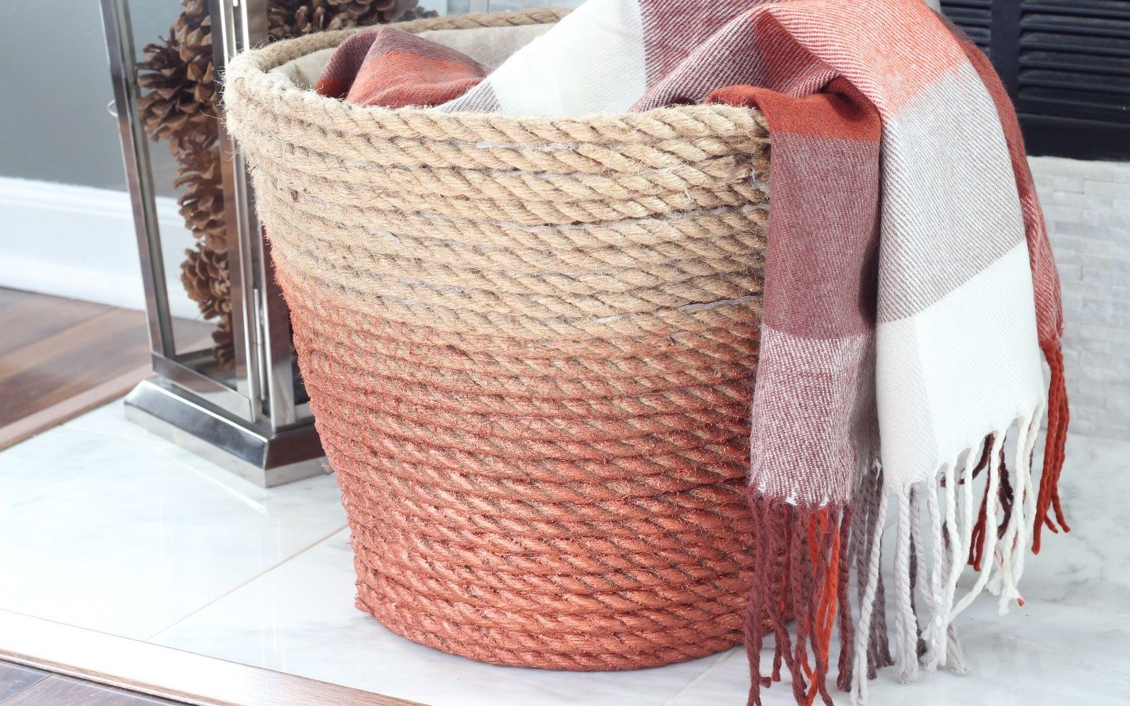 s 32 space saving storage ideas that ll keep your home organized, Turn a laundry bin into a rope basket