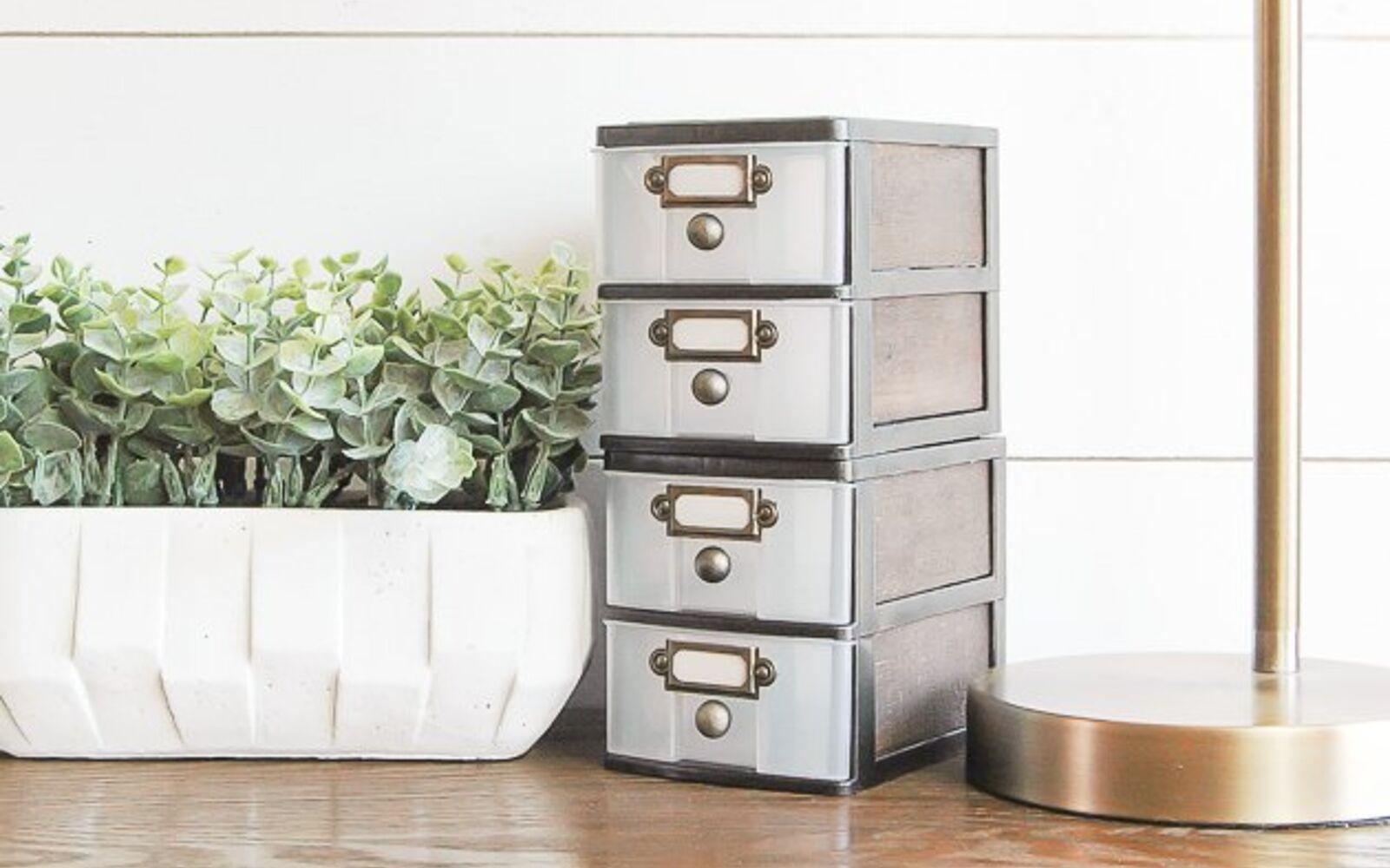 s 32 space saving storage ideas that ll keep your home organized, Turn plastic bins into farmhouse decor