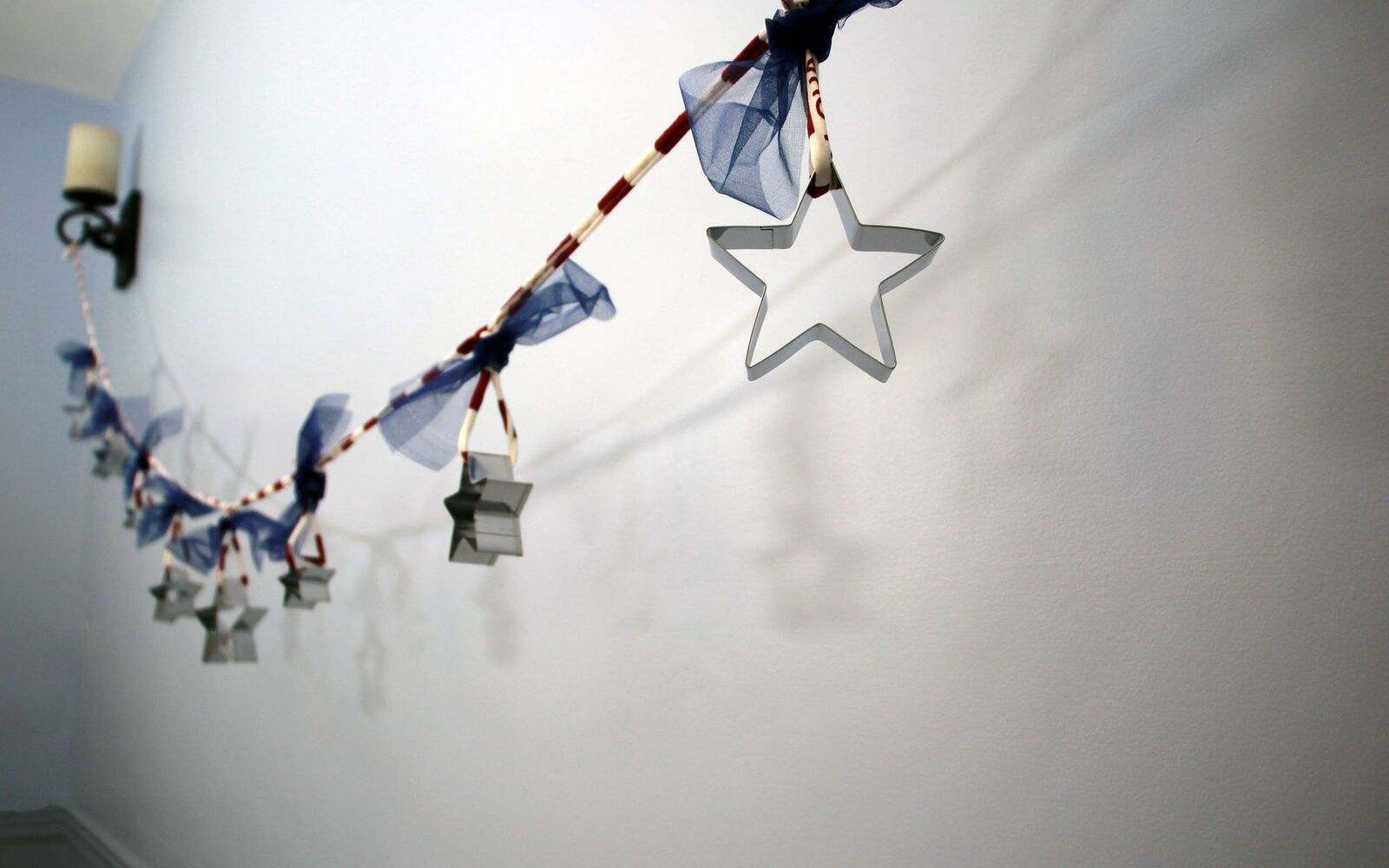 s 30 adorable diy ideas for july 4th, Hang a garland of Dollar Store cookie cutters