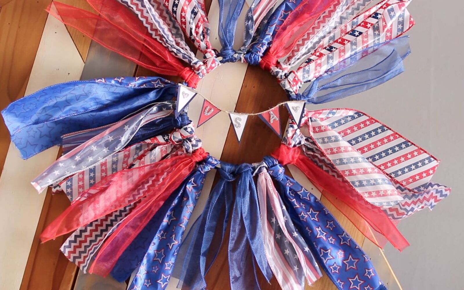 s 30 adorable diy ideas for july 4th, Make a stunning ribbon wreath