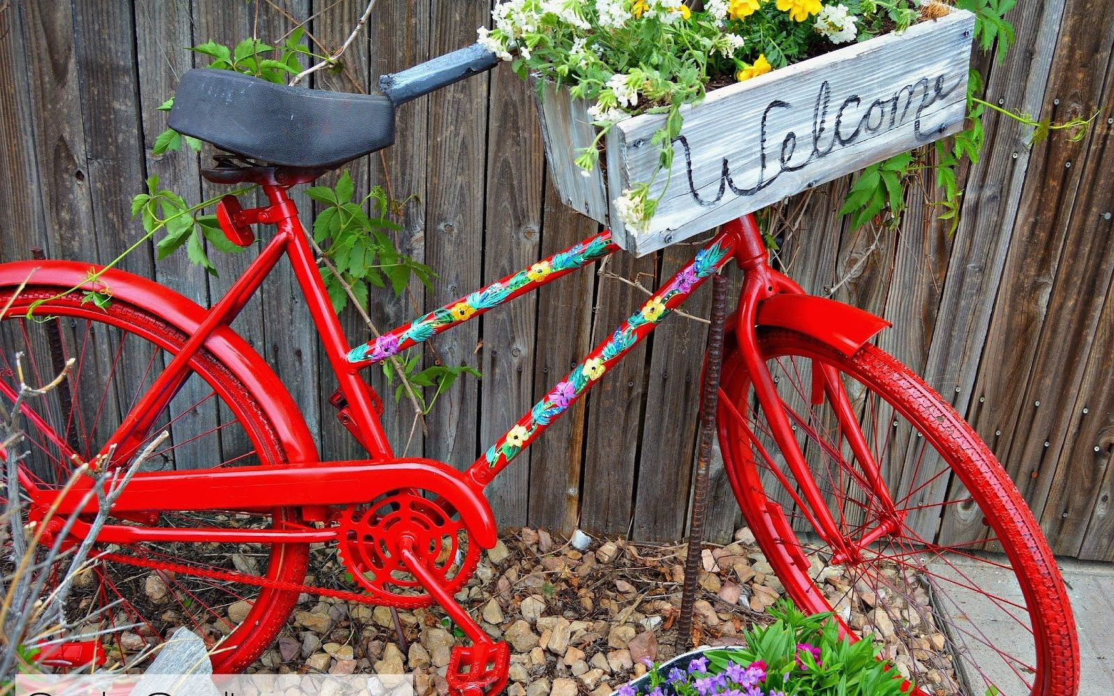 s 15 lovely repurposed items perfect for your garden, Repurpose Your Bike Into Garden Art