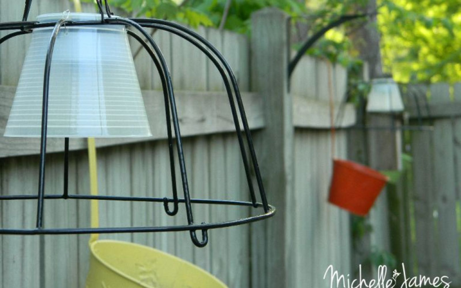 s 16 stunning ways for you to add solar lighting, Combine A Hanging Planter And Solar Lamps