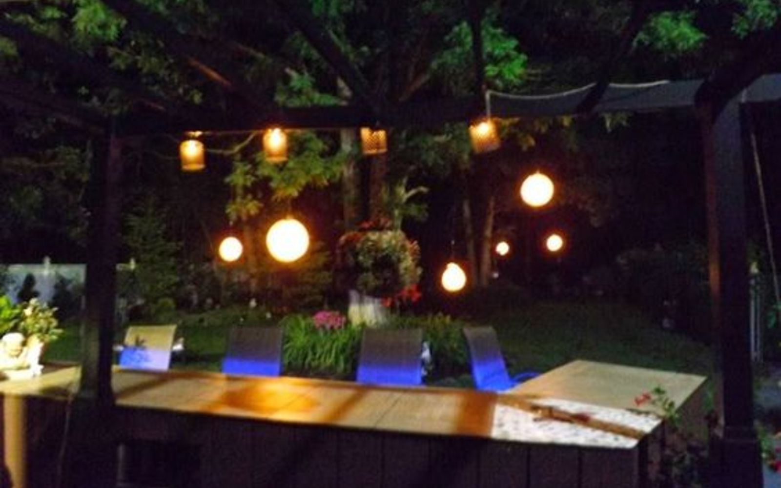 s 16 stunning ways for you to add solar lighting, Hang Solar Lights In The Garden