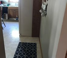 q i have an empty entry into my kitchen does anyone suggest putting so