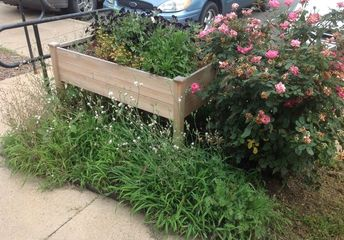 q how can i keep the area under my raised flower bed neat and weed free