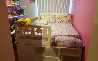 double bed with storage and a hiding nook