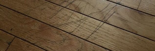 q how do i get rid of scratches on my wooden floor without redoing the