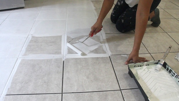 The secret is out how to stencil a tile floor hometalk for How to get paint out of wood floors