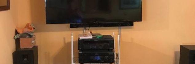 q hi i have a tv on my wall and need to house cable box etc open look