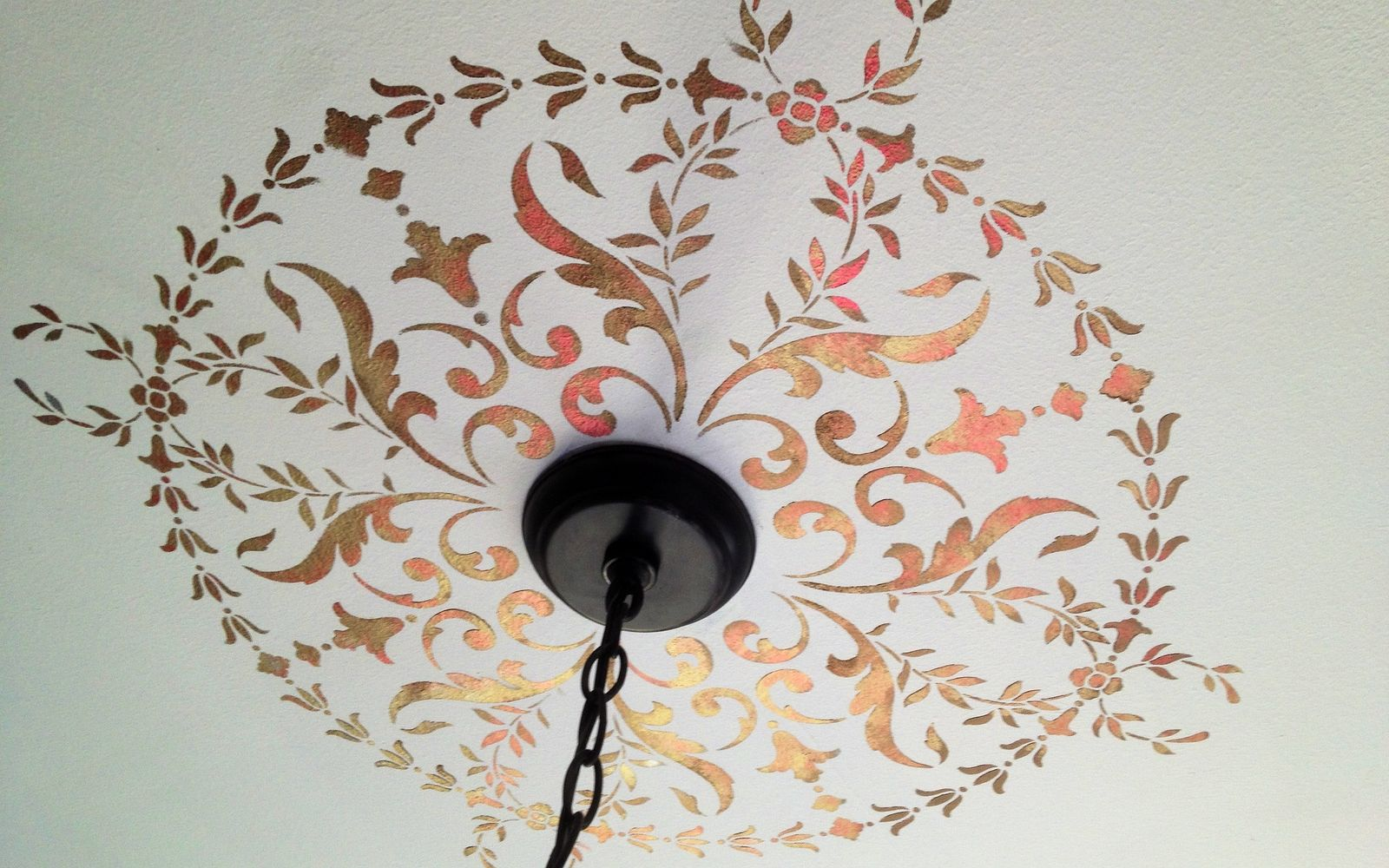 s 14 glamorous ways to upgrade your home using stencils, Stenciled Ceiling Medallion in Festive Metall