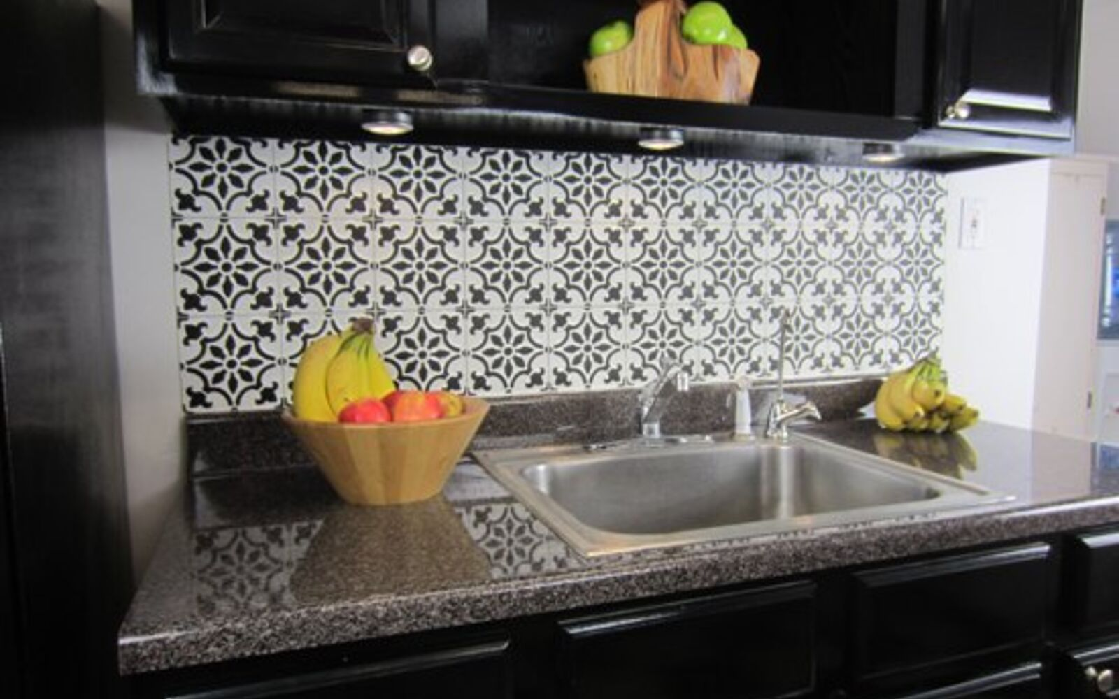 s 14 glamorous ways to upgrade your home using stencils, Stencil A Faux Tile Backsplash