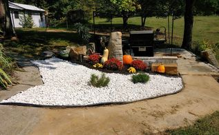 landscaping with rocks and mums