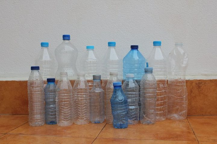 Gardeners save your plastic bottles and make this to hang for How do i make a wall with colored bottles