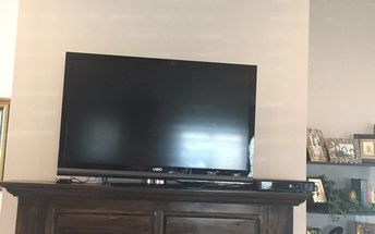 q decorating a manel with a tv setting on it