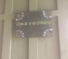 welcome sign with scrap wood and unicorn spit