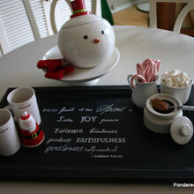 cabinet door tray and hot chocolate station, christmas decorations, doors, kitchen cabinets, repurposing upcycling, seasonal holiday decor, To create this tray we painted the cabinet door black distressed with sandpaper added an inspiration quote with a white paint and put handles on both ends It was finished off with a coat of polyurethane for protection