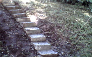 we made steps from decorative concrete blocks, concrete masonry, gardening, repurposing upcycling, stairs, My grandson helped with the heavy stuff I had bags of Quckcrete left by my x huband So all materials cost zip I am going to make a cement slab at the base and landing Then add hostas perrenial flowering plants on the sides