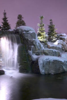 create a cozy winter water garden, gardening, lighting, outdoor living, ponds water features, Lights behind the waterfall create a cozy enchanting view