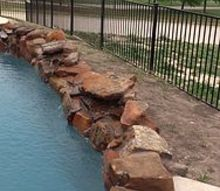 how do we landscape around our pool, landscape, pool designs, This is the backside of the pool We would like to use small rock for covering No idea what to plant Remember this can be viewed by folks driving by