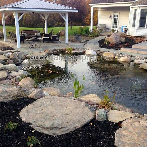 Here's a backyard pond we constructed(Acorn Landscaping) in Rochester NY last year. Is anyone thinking about getting a pond installed this year?